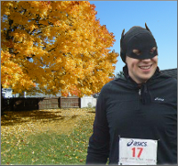 A runner in a batman Halloween costume